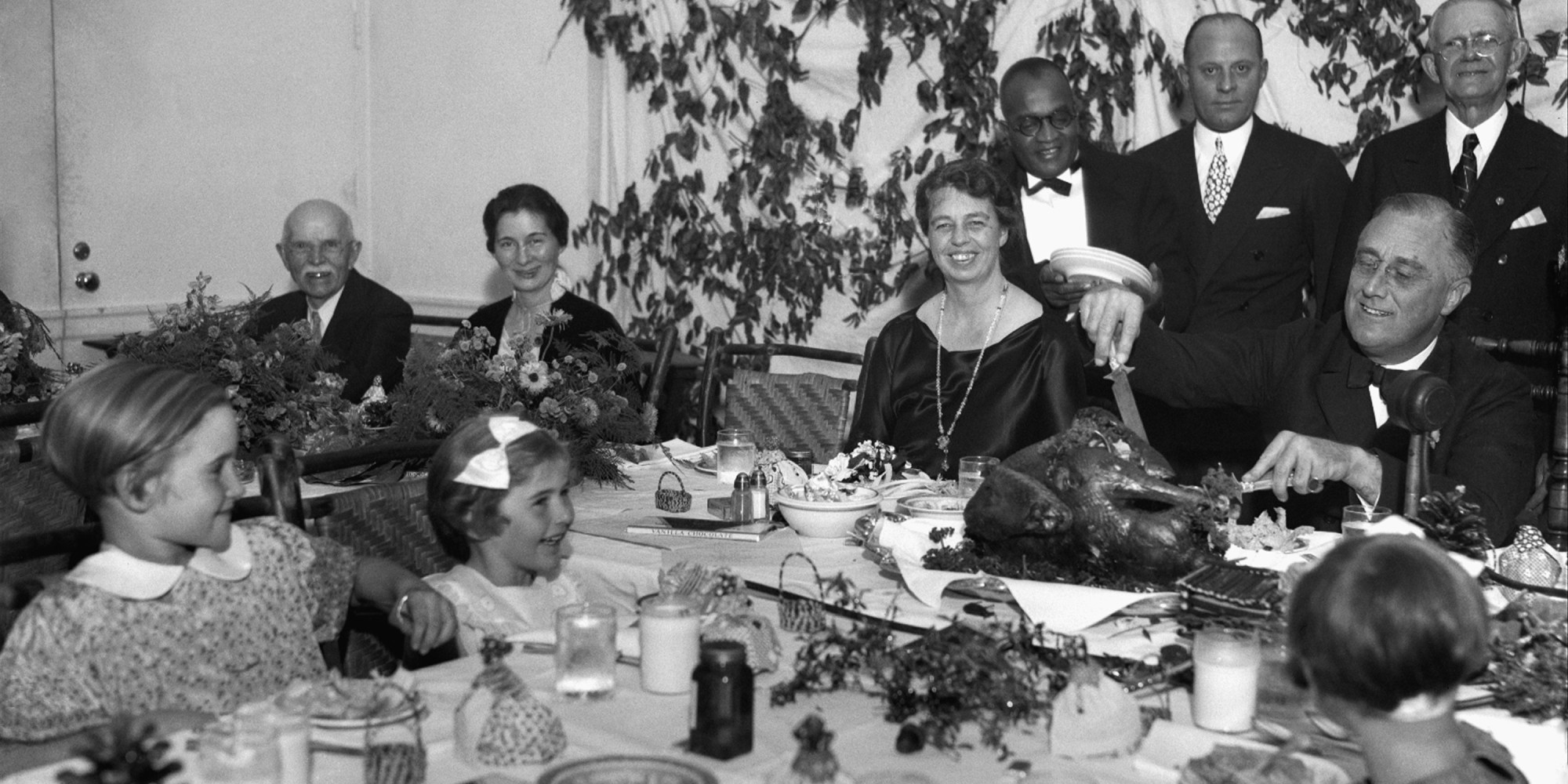 President Franklin D. Roosevelt carves the turkey during the annual Thanksgiving dinner for polio patients at Warm Springs, Ga., with first lady Eleanor Roosevelt smiling beside him, Dec. 1, 1933. (AP Photo)